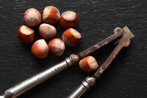 Old nutcracker and hazelnuts