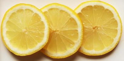 Three isolated lemon slices