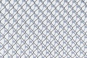black and white metal chain link fence