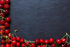 Cherries on slate background