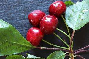 A bunch of cherries and leaves