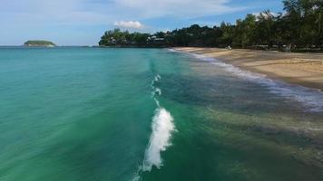 Aerial: Flying over the waves on Kata Noi beach.