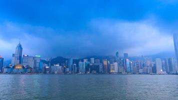 Hong Kong Victoria Harbour Cityscape Day To Night Time Lapse Of HongKong City, China (zoom out)