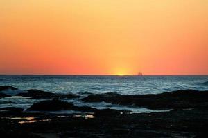 Sailboat at sunset, Tamarindo, Costa Rica photo
