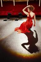 Beautiful Woman In Red Gown On Stage