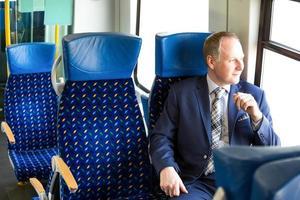 Businessman sitting in a train