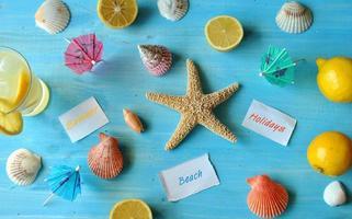 Fresh lemonade with starfish and seashells