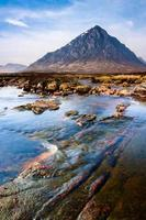 Scottish highlands landscape scene with mountain and river photo