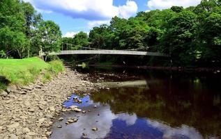 Suspension bridge and River Cree photo