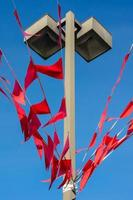 Red flags or banners on a pole