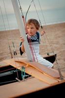 Portrait of young sailor near yacht