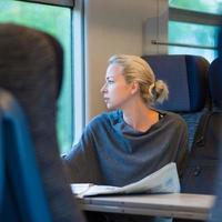 Lady traveling by train. photo