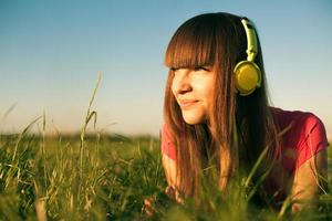 Beautiful Young Woman with Headphones Outdoors.