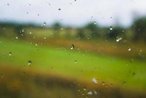 Raindrops on a train window pane.