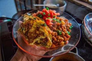Beans and tomatoes on glass plate