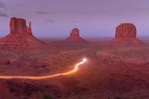 Brown rock formation with light trails