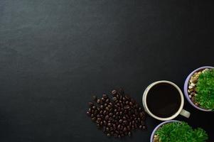 Coffee beans and mug on the desk photo