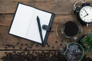 Notebook and coffee beans on the desk