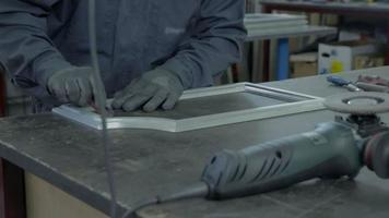 Sharpening white frame with sand paper