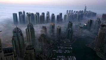 aerial view skyscraper foggy weather Dubai Marina at morning