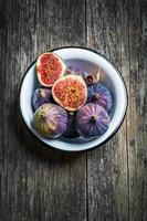 Fresh figs on wooden background photo