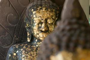 close up Buddha statue gilded in the measure