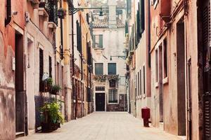 Narrow, old street in Venice, Italy photo