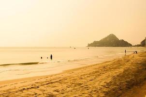Sunset at tropical summer beach photo