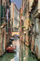 Venice, Italy. A romantic narrow canal and bridge photo