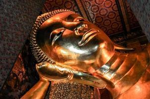 Buddha gold statue . Wat Pho, Bangkok, Thailand photo