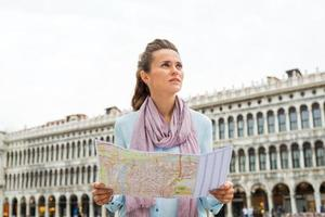 Woman on St. Mark's Square looking into distance photo