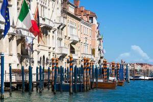 Venice Grand Canal mooring poles, taxi, European and Italian Flag photo