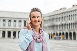 Woman talking on mobile in St. Mark's Square photo