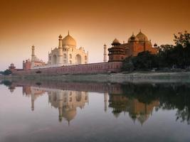 Taj Mahal sunset with reflections. from lake side.