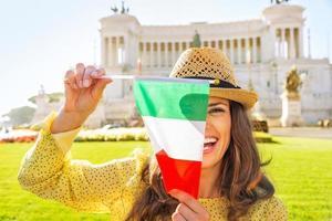Woman showing italian flag on piazza venezia in rome, italy photo