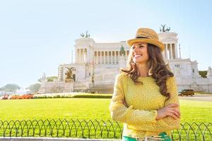 Portrait of happy woman on piazza venezia in rome, italy photo