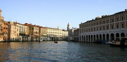 Venice, the canal and the tourist wooden gondolas photo