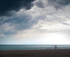 lifeguard chair on the beach photo