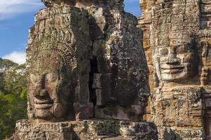 Ancient stone face of Bayon temple photo