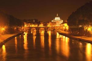 Monumental St. Peters Basilica over Tiber at night, Rome, Italy