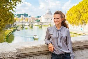 Portrait of happy young woman  in Rome, italy photo
