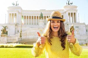 Portrait of smiling woman showing thumbs up in rome, italy photo