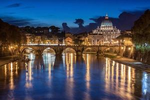 St. Peter's Basilica at night in Rome, Italy photo