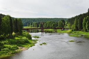 The automobile bridge through the river photo