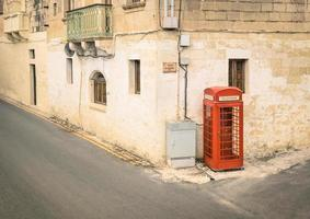 Red telephone cabin in medieval old town Victoria in Gozo