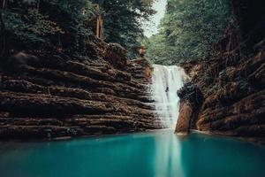 Waterfall in majestic rocky ravine photo