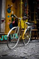 A yellow city bike parked on colorful alleyway