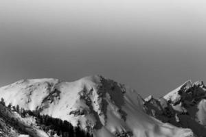 Grayscale of snowy mountains