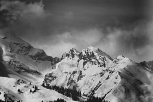 Grayscale of snowcapped mountains