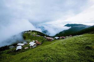 Small village in green grassy mountains